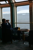 Polar cruising, bar service, tourist. Using binoculars to see the glaciers,Lemaire Channel,Antarctica Royalty Free Stock Image