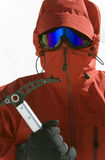 Polar Exploration. Man in red Arctic clothing holding an ice axe
