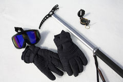 Polar Exploration Gear. Ice axe, compass, ski mask and gloves Stock Images