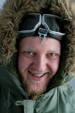 In polar flying helmet. And a green jacket alaska Royalty Free Stock Photo
