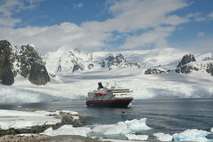 Polar landing boat approaching cruise ship. Glaciers inbackground,Petermann Island,Antarctica Stock Photography