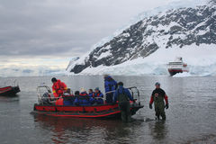 Polar landing boat returning tourists to cruise ship Royalty Free Stock Photos