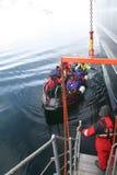 Polar landing boat returning tourists to cruise ship Royalty Free Stock Images