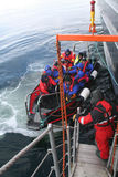 Polar landing boat returning tourists to cruise ship Stock Photo