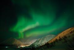 Polar light over settlement. Polar light over a mountain valley royalty free stock photos