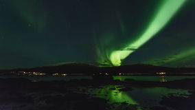 Polar lights (aurora borealis) in a fjord in Norway stock video footage