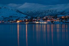 Polar night in Norway. Winter landscape with Norwegian fjords and evening light reflections on water Stock Images