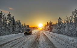Polar Night Sunset over road in Finland Stock Photo