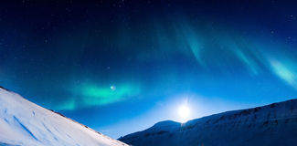 Polar Northern lights in Norway. The polar Northern lights in Norway Svalbard in the mountains moon Royalty Free Stock Images