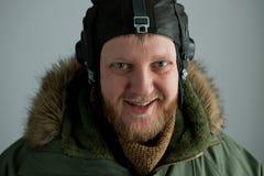 Polar pilot in alaska green jacket. And flying helmet Royalty Free Stock Photo