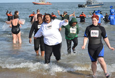 Polar Plunge 2013. Virginia Beach, Virginia - February 2, 2013: Special Olympic Polar Plunge participants run out of the water in the main event held on February stock photo