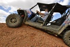 Polaris ATV vehicle on scoria rock Stock Image