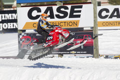 Polaris Red & Black Snowmobile Getting some Air. EAGLE RIVER, WI - MARCH 2:  Polaris Red and black Snowmobile Getting some Air during a race on March 2, 2013 in Stock Images