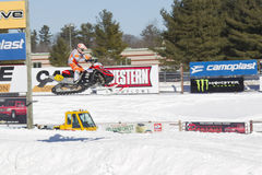 Polaris Red & Black Snowmobile High in the Air 2. EAGLE RIVER, WI - MARCH 2:  Polaris Red and black Snowmobile high in the Air during a race on March 2, 2013 in Stock Photography