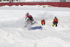 Polaris Red & Black Snowmobile Jumping Royalty Free Stock Photo
