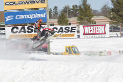 Polaris Red & Black Snowmobile Soaring on Jump. EAGLE RIVER, WI - MARCH 2:  Polaris Red and black Snowmobile Soaring on Jump during a race on March 2, 2013 in Stock Photography