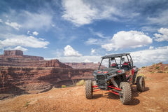 Polaris RZR ATV on Chicken Corner 4WD trail near Moab. MOAB, UT, USA - MAY 7, 2017: Polaris RZR ATV on a popular Chicken Corner 4WD trail in the Moab area Stock Images