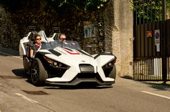 Polaris Slingshot at Bergamo Historic Grand Prix 2017. A Slingshot , the tripod motorbike by Polaris  going down trough the chicane of Boccola street in Citta` Royalty Free Stock Images