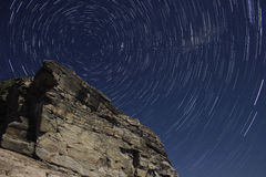 Polaris, star trails and rock. Royalty Free Stock Images
