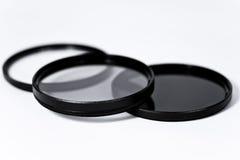 Polarisator, UV, neutrale dichtheid op wit Stock Foto