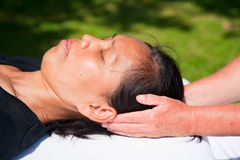 Polarity massage. A technique of gently rocking, holding and massaging to stimulate relaxation, restore energy flow and encourage revitalization Royalty Free Stock Photos