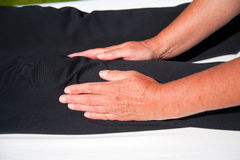 Polarity massage. A technique of gently rocking, holding and massaging to stimulate relaxation, restore energy flow and encourage revitalization Royalty Free Stock Photo
