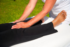 Polarity massage. A technique of gently rocking, holding and massaging to stimulate relaxation, restore energy flow and encourage revitalization Stock Images