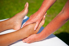 Polarity massage. A technique of gently rocking, holding and massaging to stimulate relaxation, restore energy flow and encourage revitalization Royalty Free Stock Image