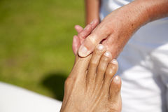 Polarity massage. A technique of gently rocking, holding and massaging to stimulate relaxation, restore energy flow and encourage revitalization Stock Image