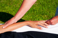 Polarity massage. A technique of gently rocking, holding and massaging to stimulate relaxation, restore energy flow and encourage revitalization Stock Photography