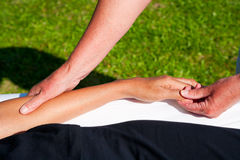 Polarity massage. A technique of gently rocking, holding and massaging to stimulate relaxation, restore energy flow and encourage revitalization Royalty Free Stock Photography