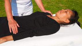 Polarity massage. A technique of gently rocking, holding and massaging to stimulate relaxation, restore energy flow and encourage revitalization Stock Photo