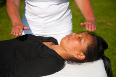 Polarity massage. A technique of gently rocking, holding and massaging to stimulate relaxation, restore energy flow and encourage revitalization Royalty Free Stock Images