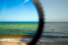Polarization filter. Test of polarization filter on the beach Royalty Free Stock Images