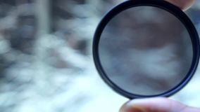 Polarizing filter for the camera. Polarizing filter for close-up camera in hand stock footage