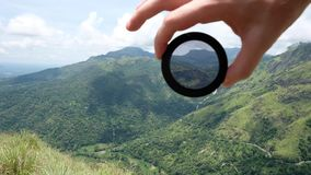Polarizing filter for camera lens in photography. How it is working on real nature conditions stock footage