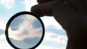 Polarizing filter for the camera. Polarizing filter for camera looking at the sky stock footage