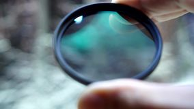 Polarizing filter for the camera. Polarizing filter for close-up camera in hand stock video