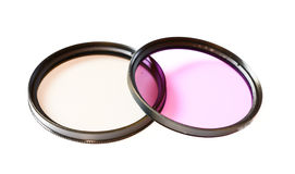 Polarizing and fluorescence lens filter isolated on white background. Photo abstract Stock Photography