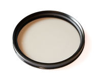 Polarizing and fluorescence lens filter isolated on white background. Photo abstract Stock Images