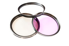 Polarizing, protect and fluorescence lens filter isolated on white background. Photo abstract Stock Images