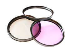 Polarizing, protect and fluorescence lens filter isolated on white background. Photo abstract Stock Photography