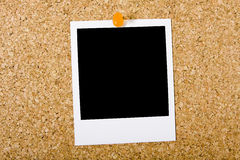 Polaroïd sur Corkboard photographie stock libre de droits