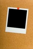 Polaroïds sur Corkboard Images stock