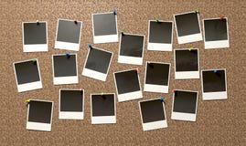 Polaroid appuntate su Cork Bulletin Board Immagine Stock