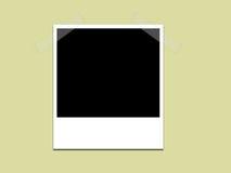 Polaroid auf grünem Hintergrund Lizenzfreies Stockfoto