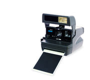 Polaroid camera. Vintage polaroid camera in white background whith foto Stock Photo