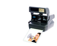 Polaroid camera. Vintage polaroid camera in white background whith foto: Man yelling into megaphone Stock Photos