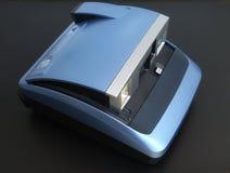 Polaroid camera. Light blue, set on a black background Royalty Free Stock Photo