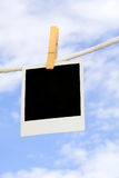 Polaroid on clothesline Royalty Free Stock Image